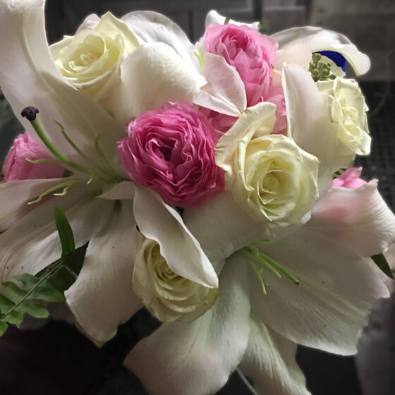 Bouquet of white lilies and bright pink flowers