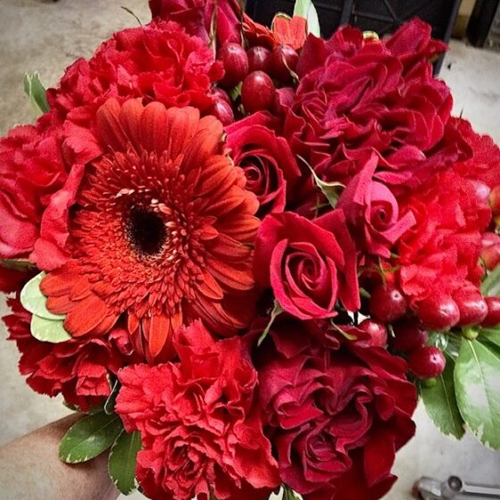 Bouquet of bright red gerberas roses and other flowers