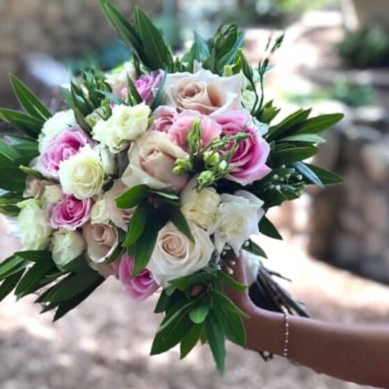 Bouquet with pink and white flowers plus deep green leaves