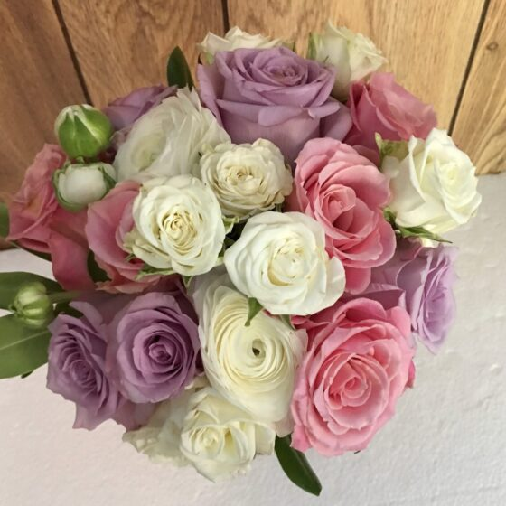 Bouquet of white, lilac and pink roses