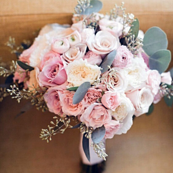 Pale pink pastel colored roses in a bouquet
