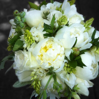 Bunch of assorted white flowers and deep green leaves