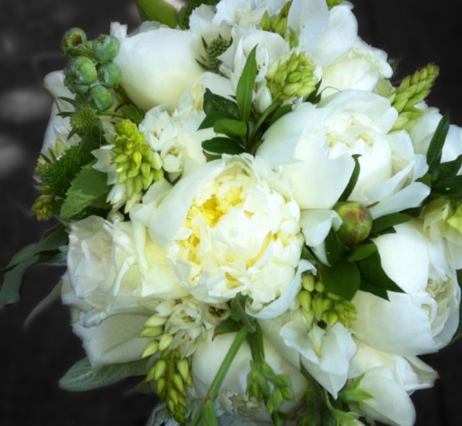 Bouquet of white flowers and greenery