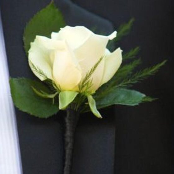 Boutonneire with a single white rose