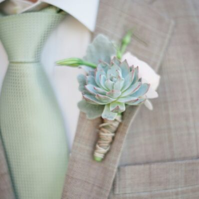 Boutonniere made from soft green succulents