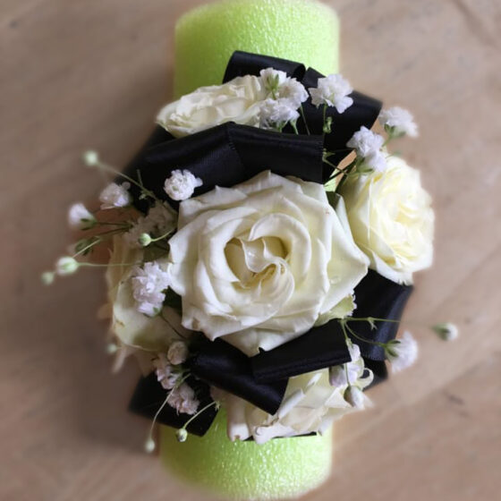 Black and white corsage on foam holder