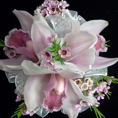 Corsage of white lilies and soft pink flowers