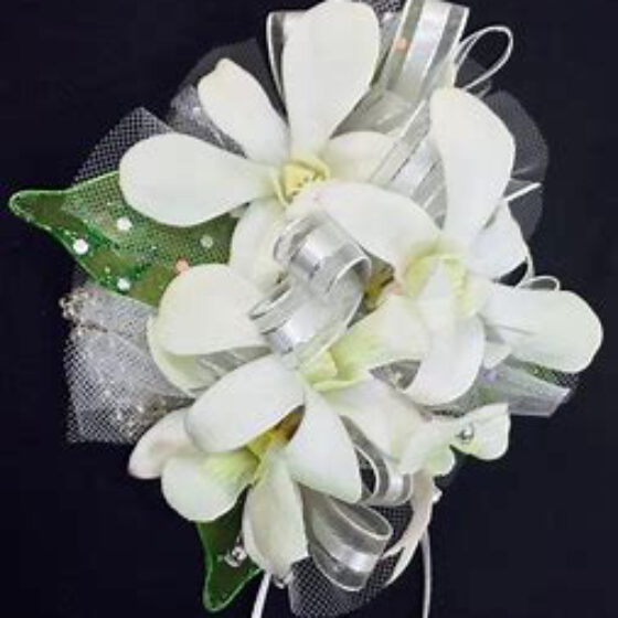 Corsage of white orchids