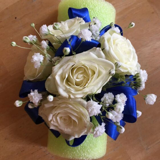 corsage of white roses and royal blue satin ribbons